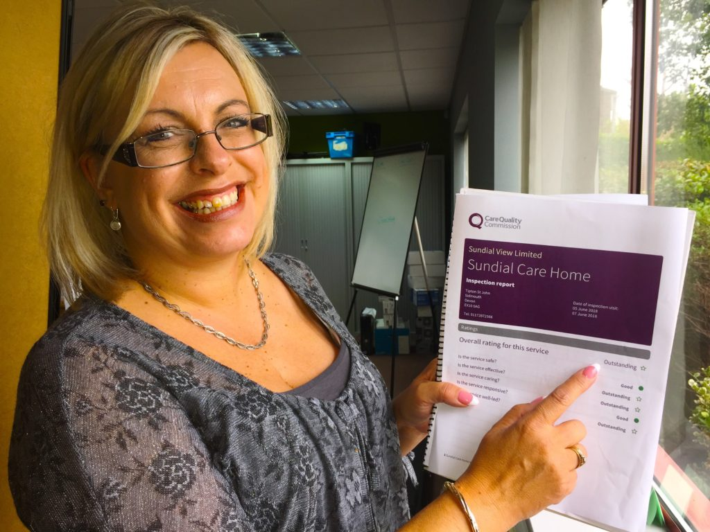 Lorraine Molloy, manager, with CQC report saying OUTSTANDING